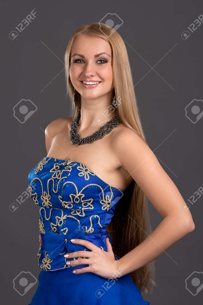 Young beautiful woman in blue dress Stock Photo - 16662740