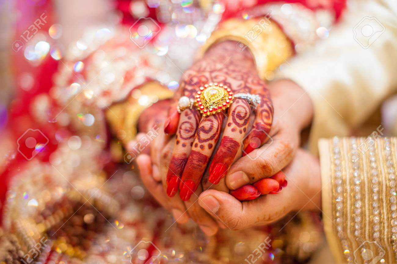 Indian wedding hands with gold - 88861767