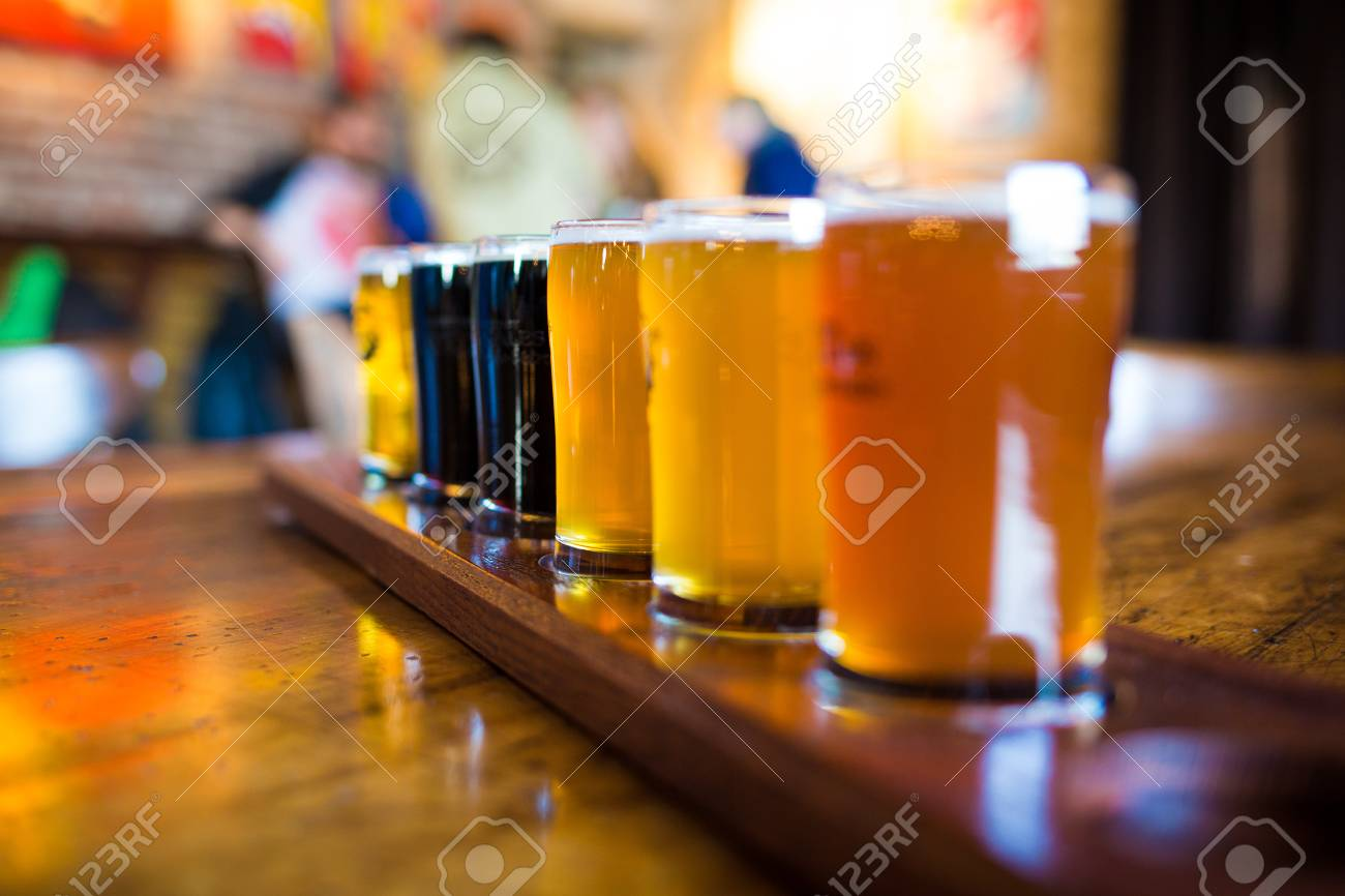 A variety set of craft beers light and dark on the table - 95432522