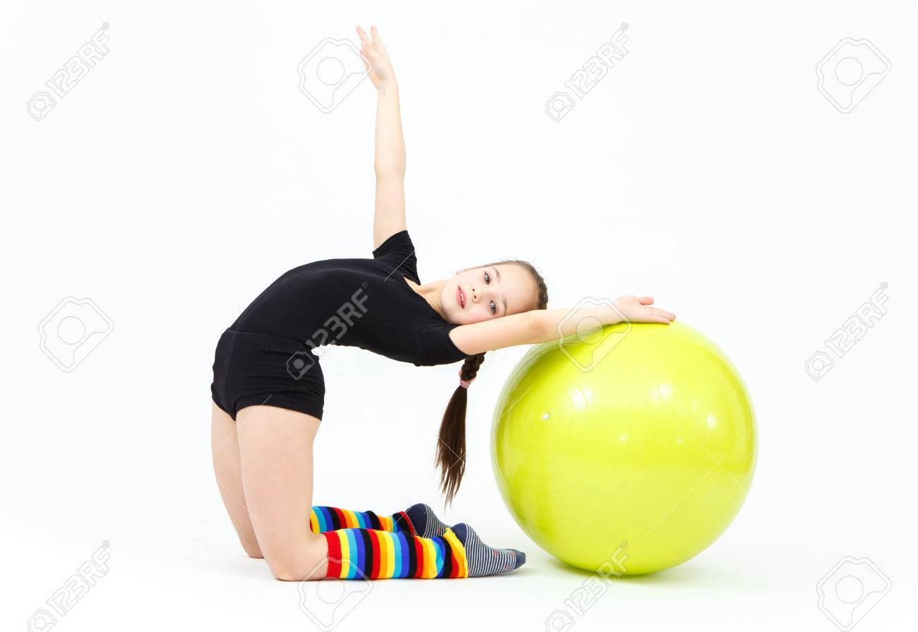 Flexible Teen Girl Doing Gymnastics Exercises On Fitness Ball Stock Photo 52965188