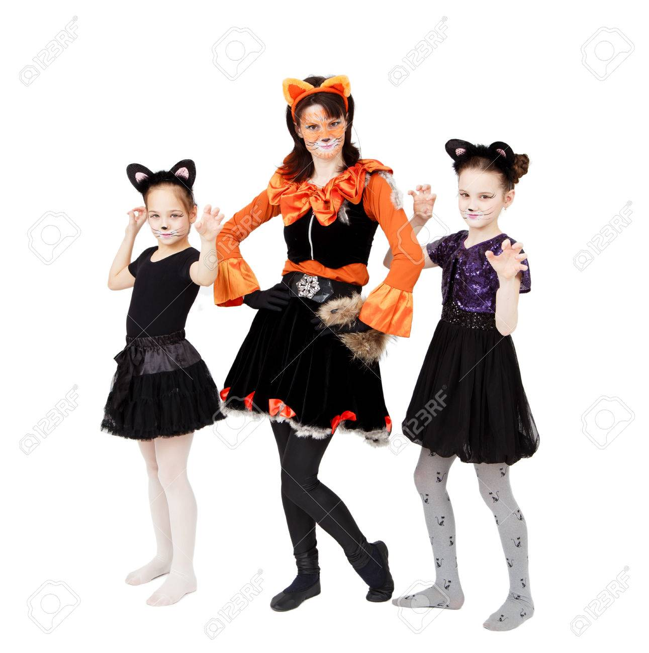 Young Woman And Two Girls In Cat Carnival Costumes Posing Stock