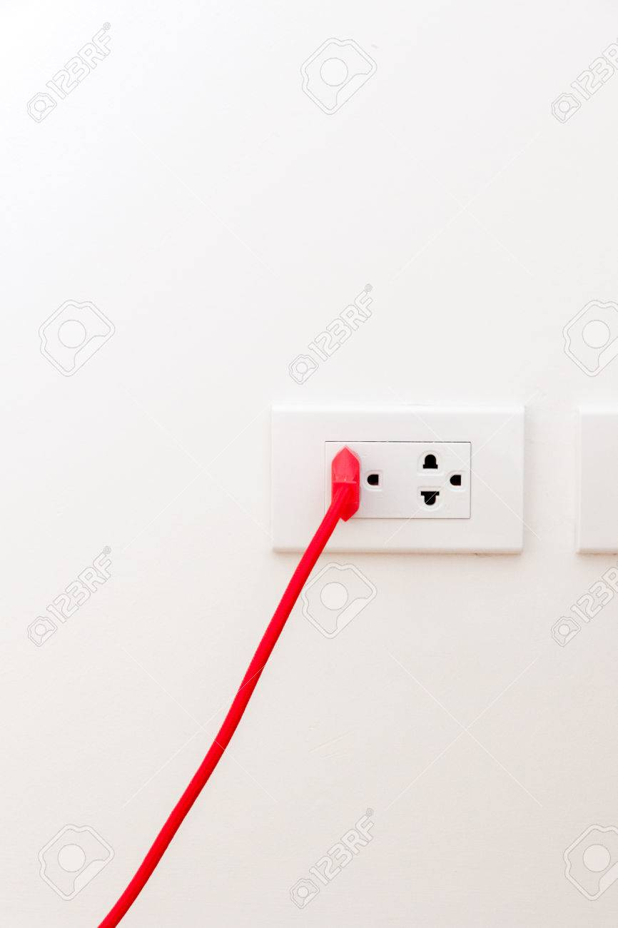 An Red Cord Plugged Into A Electrical Outlet In A House Stock Photo ...