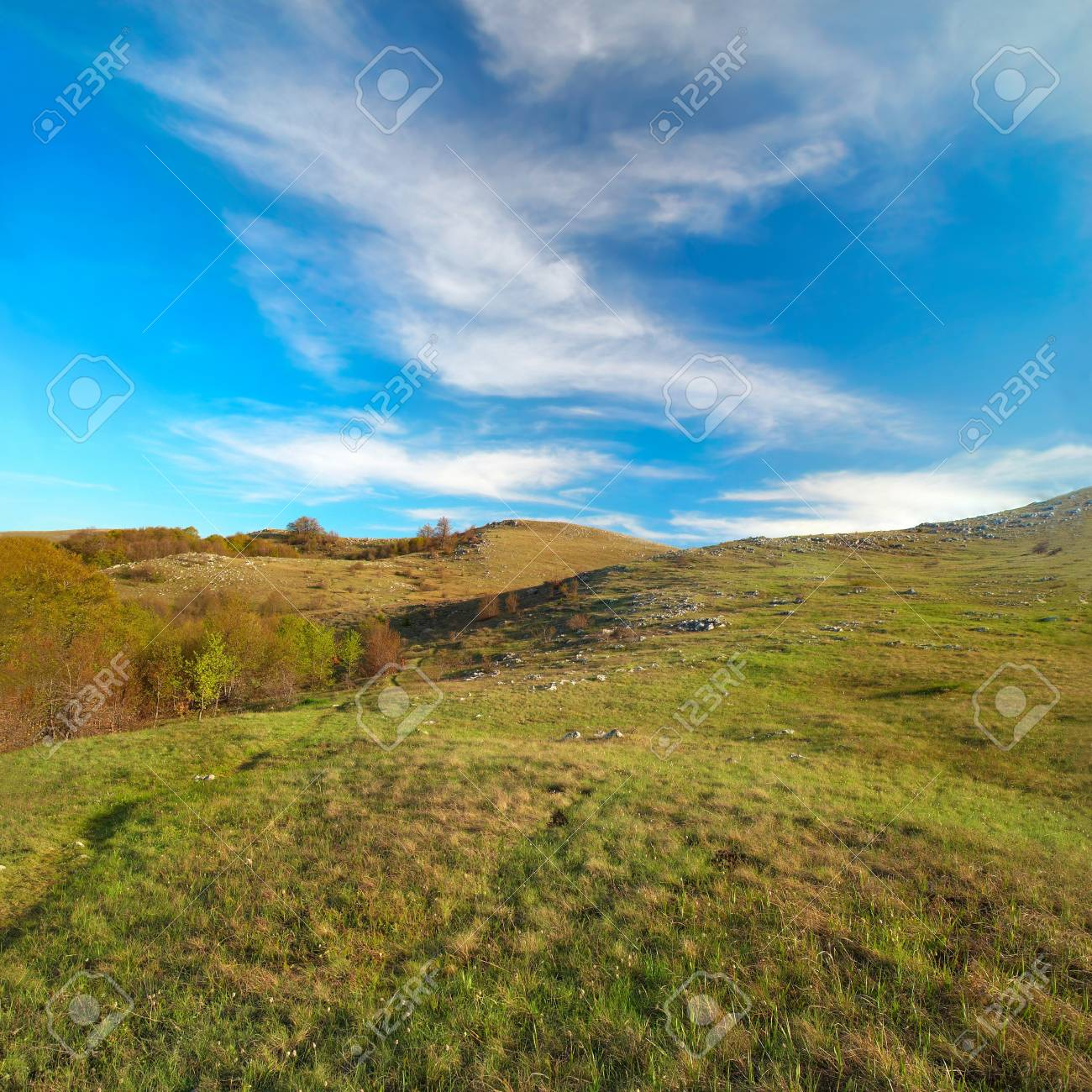 Hills with cloudscape and blue sky. Landscape. Stock Photo - 7068916