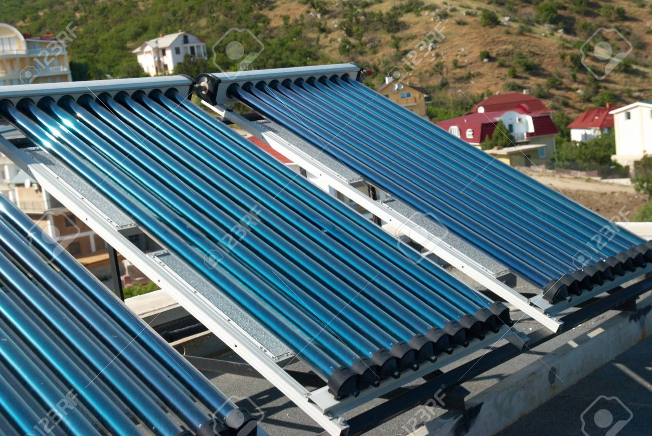 Vacuum solar water heating system on the house roof. Stock Photo - 7294647