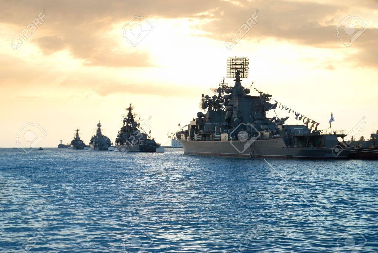 Row of military ships against marine sunset Stock Photo - 7820222