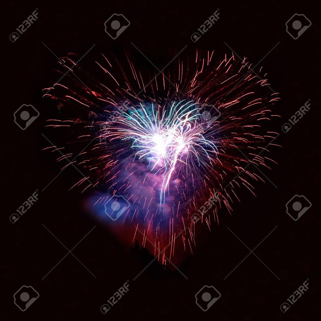 Heart fireworks on the black sky background Stock Photo - 8192257