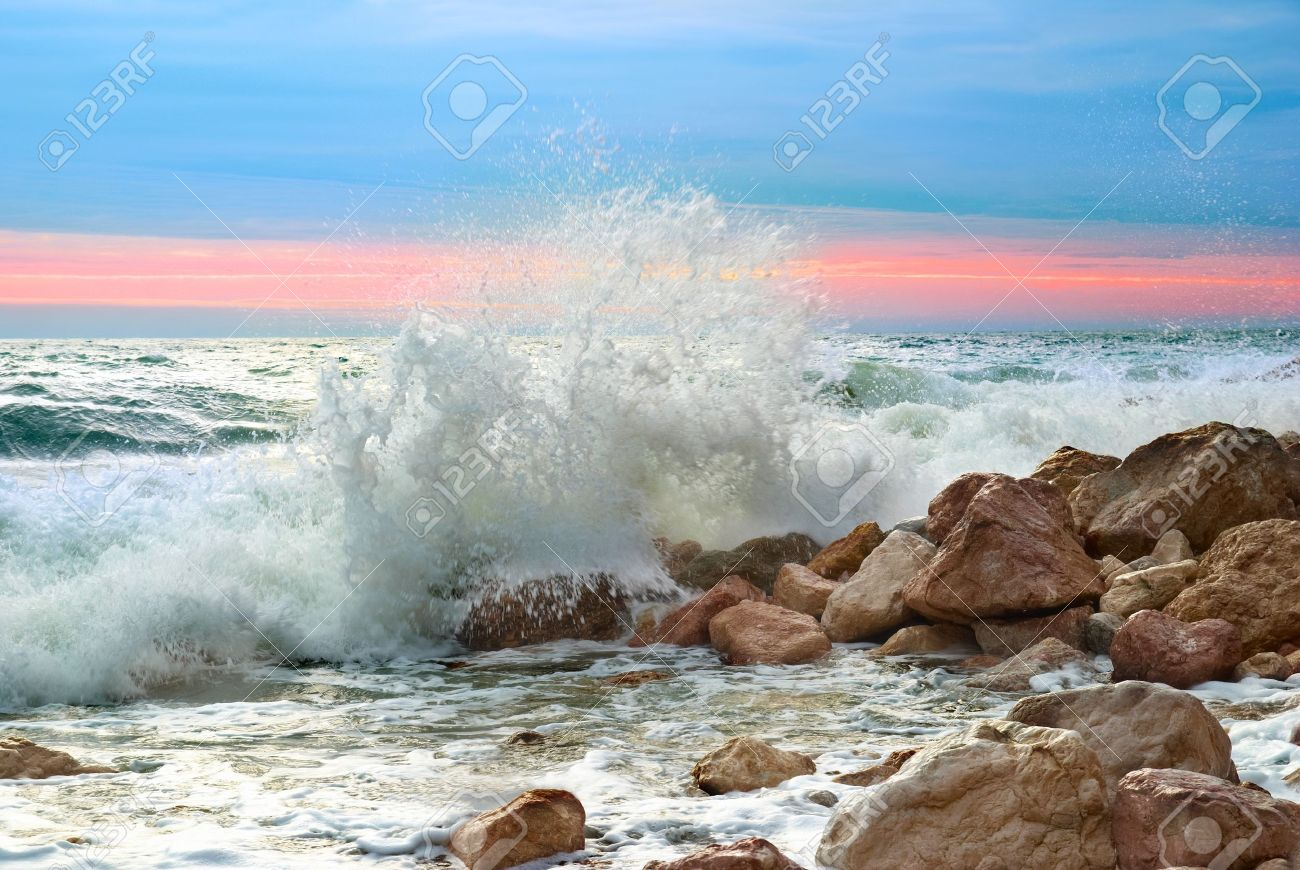 Sea landscape with waves on the beach against sunset Stock Photo - 9160646