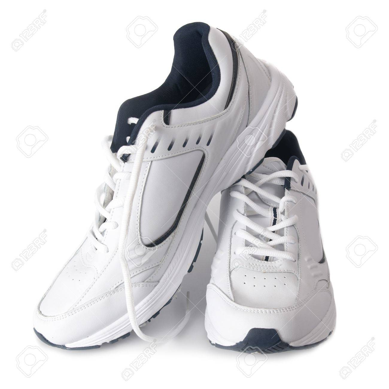 Pair white of trainers on isolated background - 10492460
