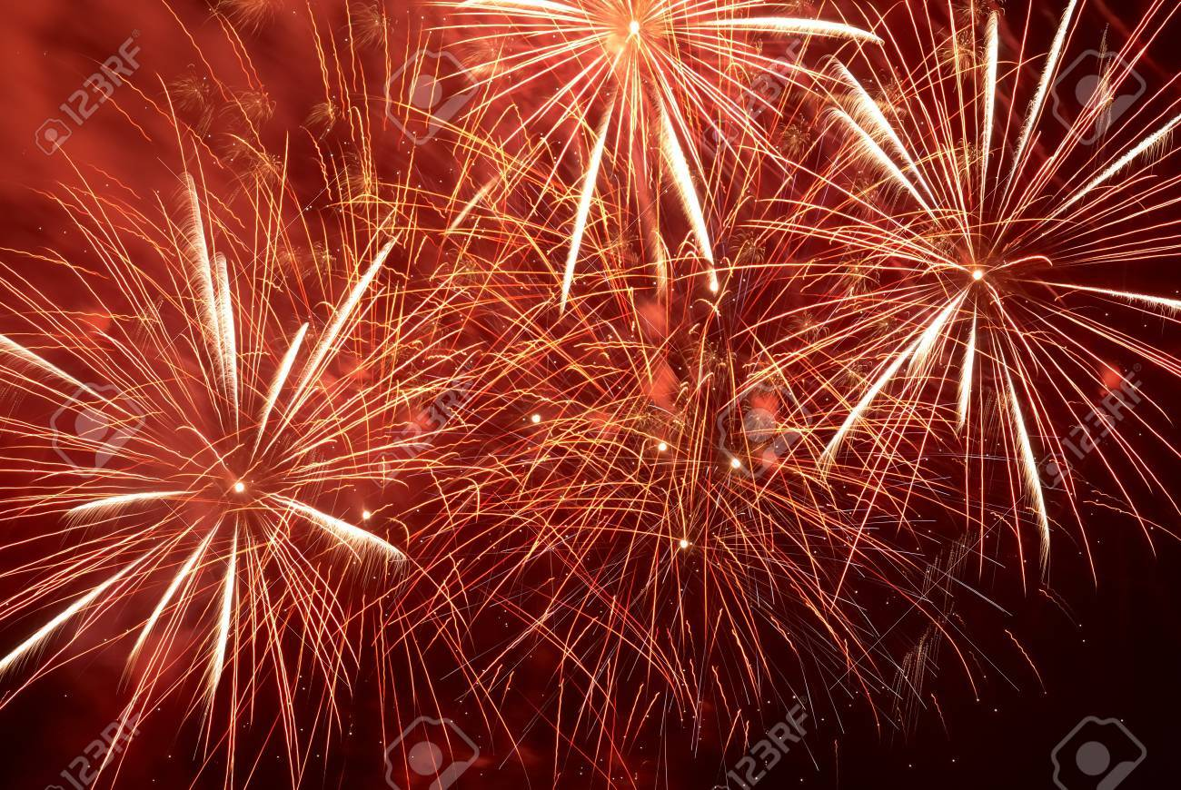 Red colorful holiday fireworks on the black sky background Stock Photo - 14664165