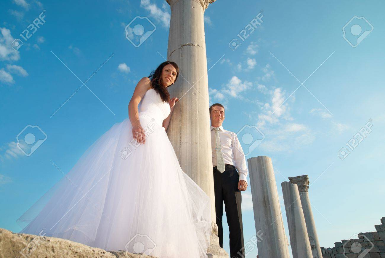 Beautiful Wedding Couple- Bride And Groom Near Greece Column.. Stock ...