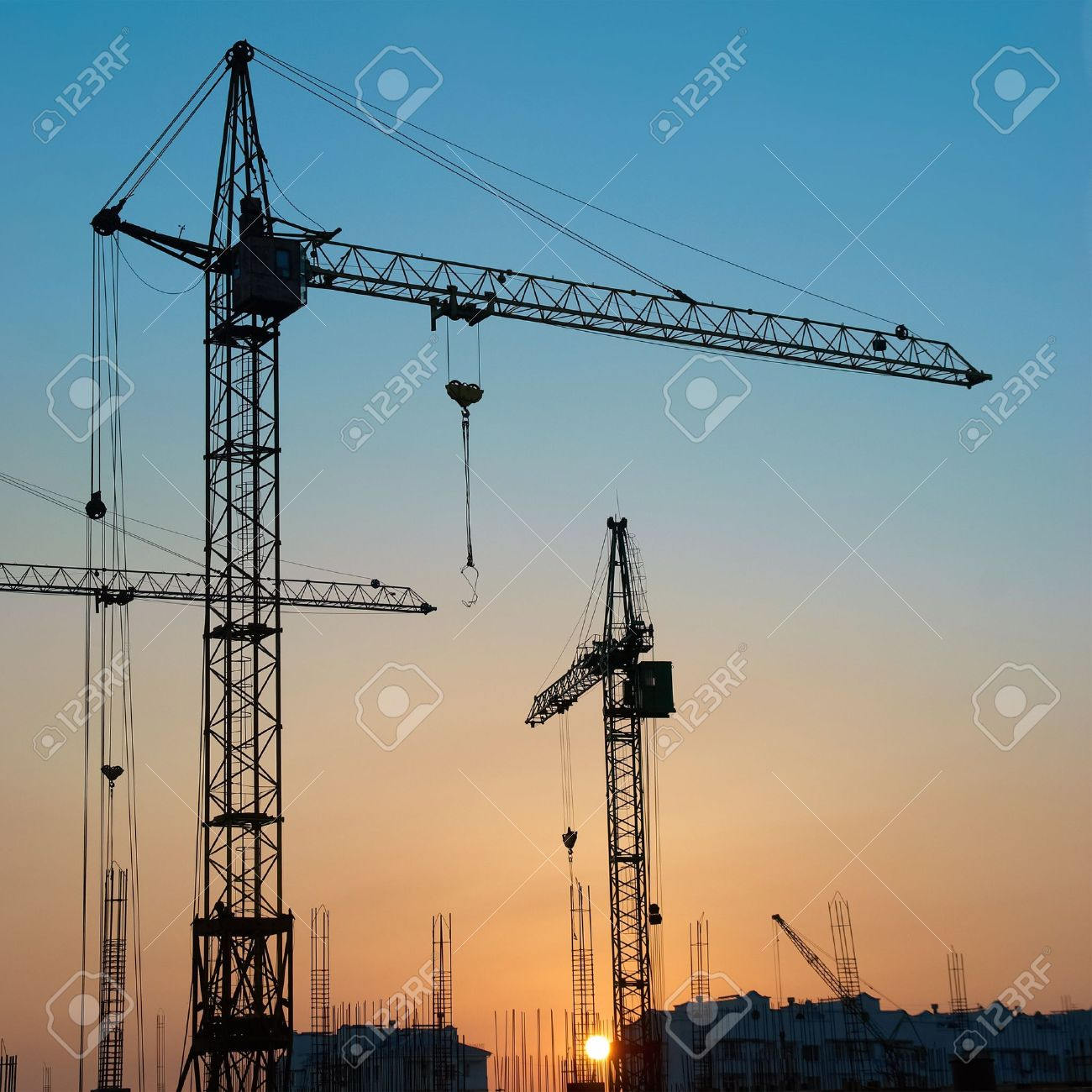 Industrial landscape with silhouettes of cranes on the sunset background Stock Photo - 16390630