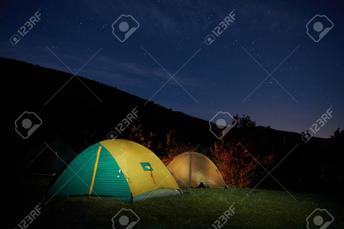 Illuminated yellow c&ing tent under stars at night Stock Photo - 17452412 & Illuminated Yellow Camping Tent Under Stars At Night Stock Photo ...