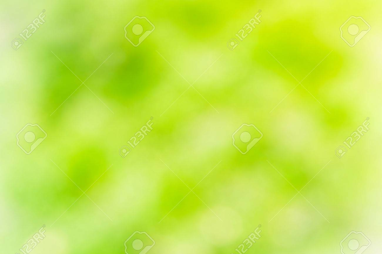 Green and yellow abstract light spots can be used for background - 52847992