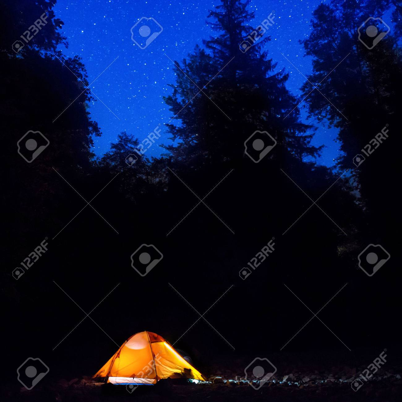 Illuminated orange tent at night in the forest under dark blue sky with many stars Stock  sc 1 st  123RF Stock Photos : dark tent - memphite.com