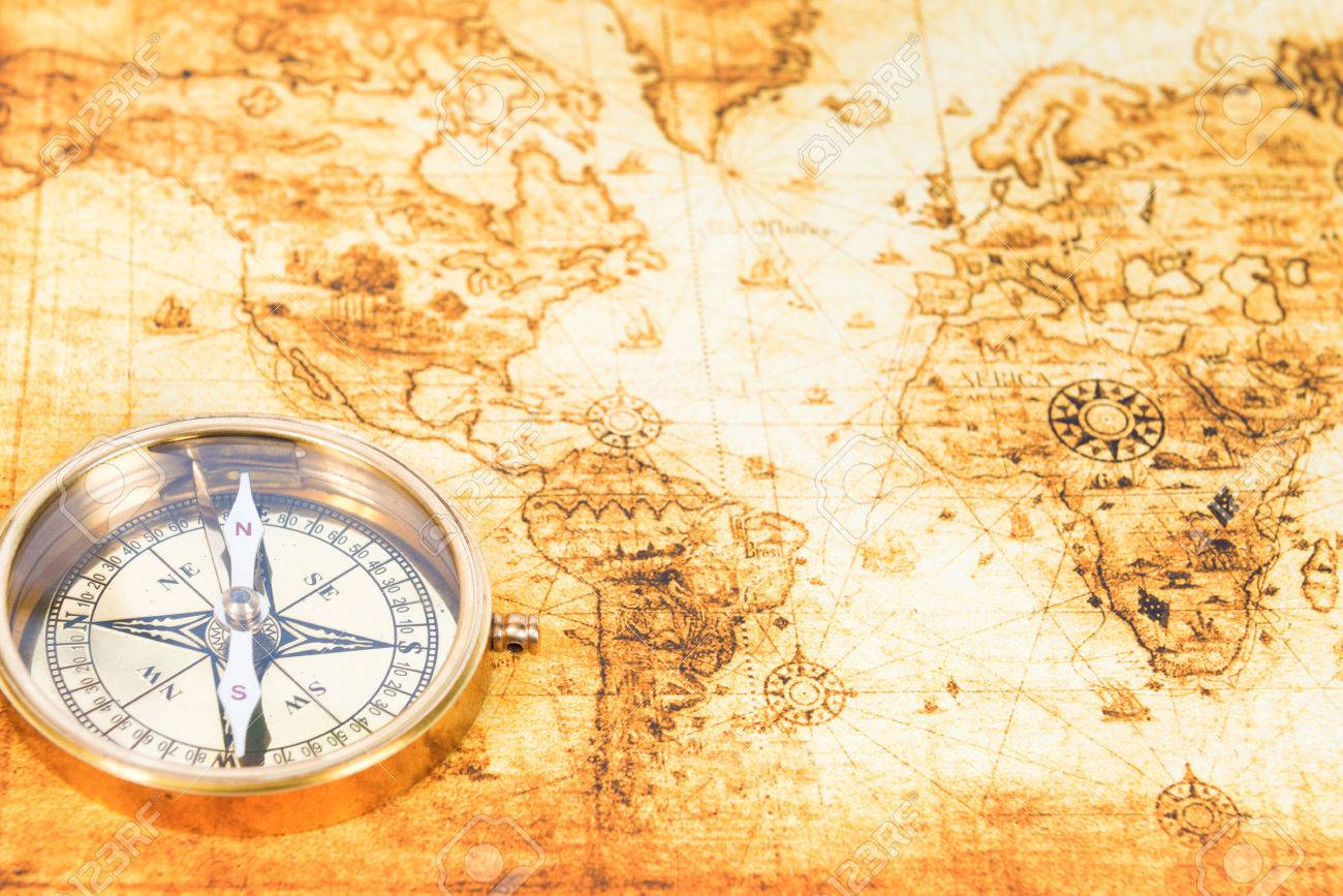 Old paper map with an ancient compass on it vintage travel old paper map with an ancient compass on it vintage travel background stock photo gumiabroncs Choice Image