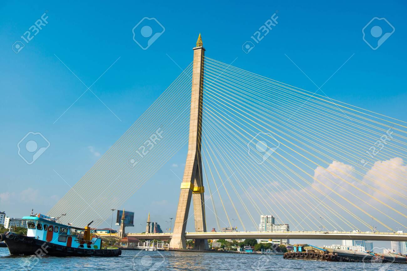 View to suspension Rama 8 Bridge across Chaophraya river at sunny day. Landmark building in Bangkok, Thailand - 141755178