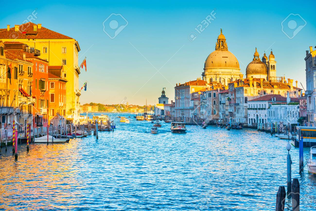 Sunset view of Grand Canal with boats and Basilica Santa Maria della Salute. Venice, Italy - 148199134