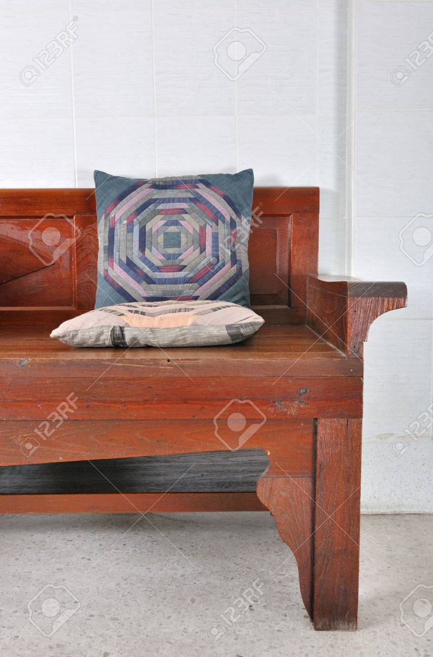 Asian Style Fabric Pillow On Old Style Wooden Sofa Stock Photo   35444755