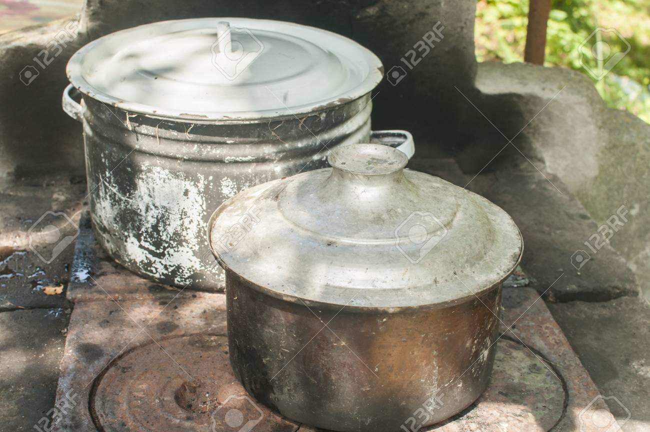 Old Vintage Grunge Metal Cooking Pots On Rural Outdoor Fireplace