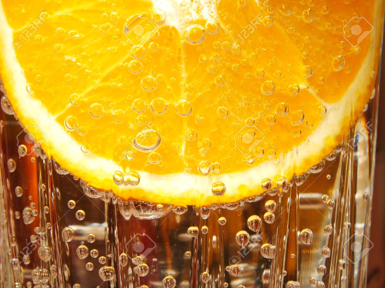 Orange slice in water with bubbles Stock Photo - 17068437