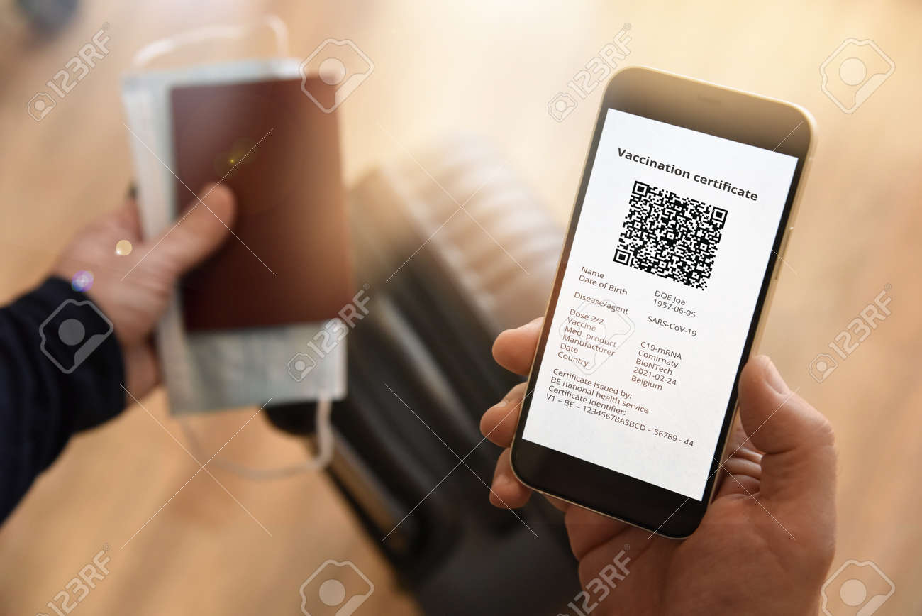 Man holding passport, face mask and certificate of vaccination against , a negative PCR test or recovery from . Business and tourism concept of travel during pandemic. - 167164348