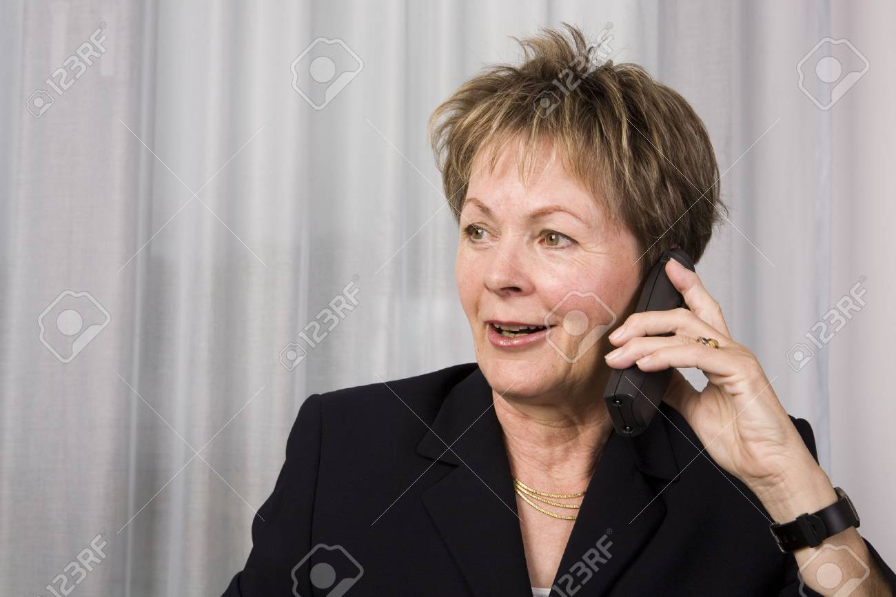 Senior business woman talking on the phone and smiling Stock Photo - 3653755