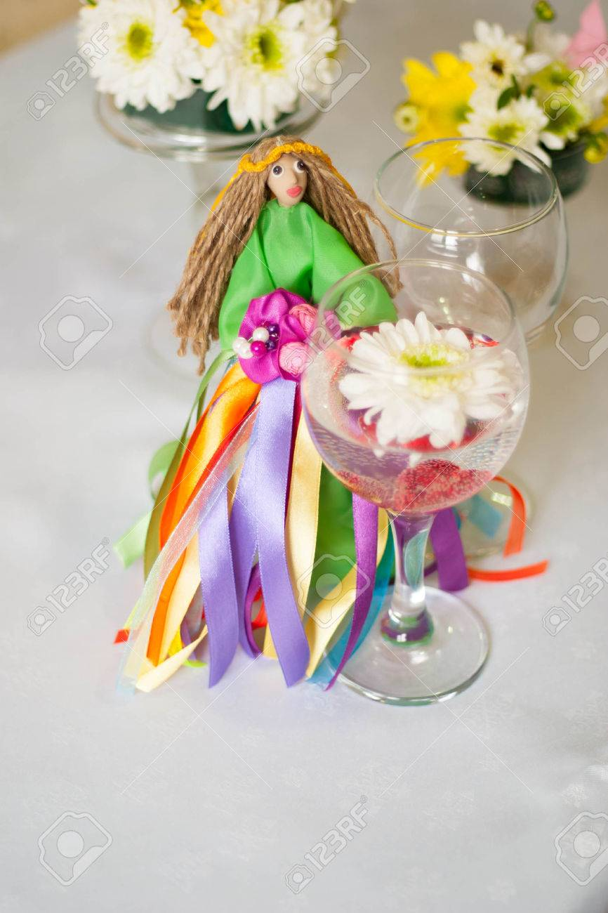 decor for the tabletop flower arrangement doll in a green dress