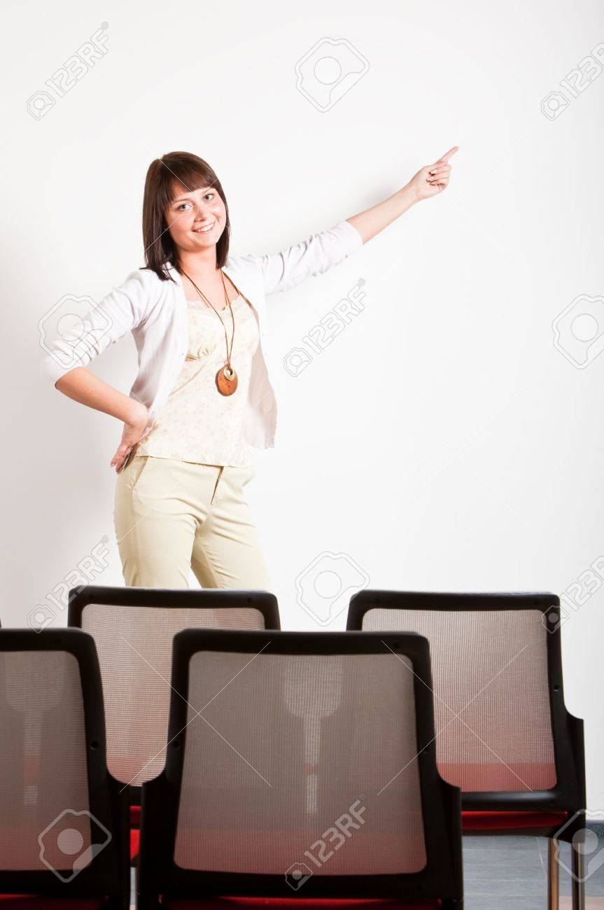 woman making a presentation in class, pointing right with finger at board Stock Photo - 6489961