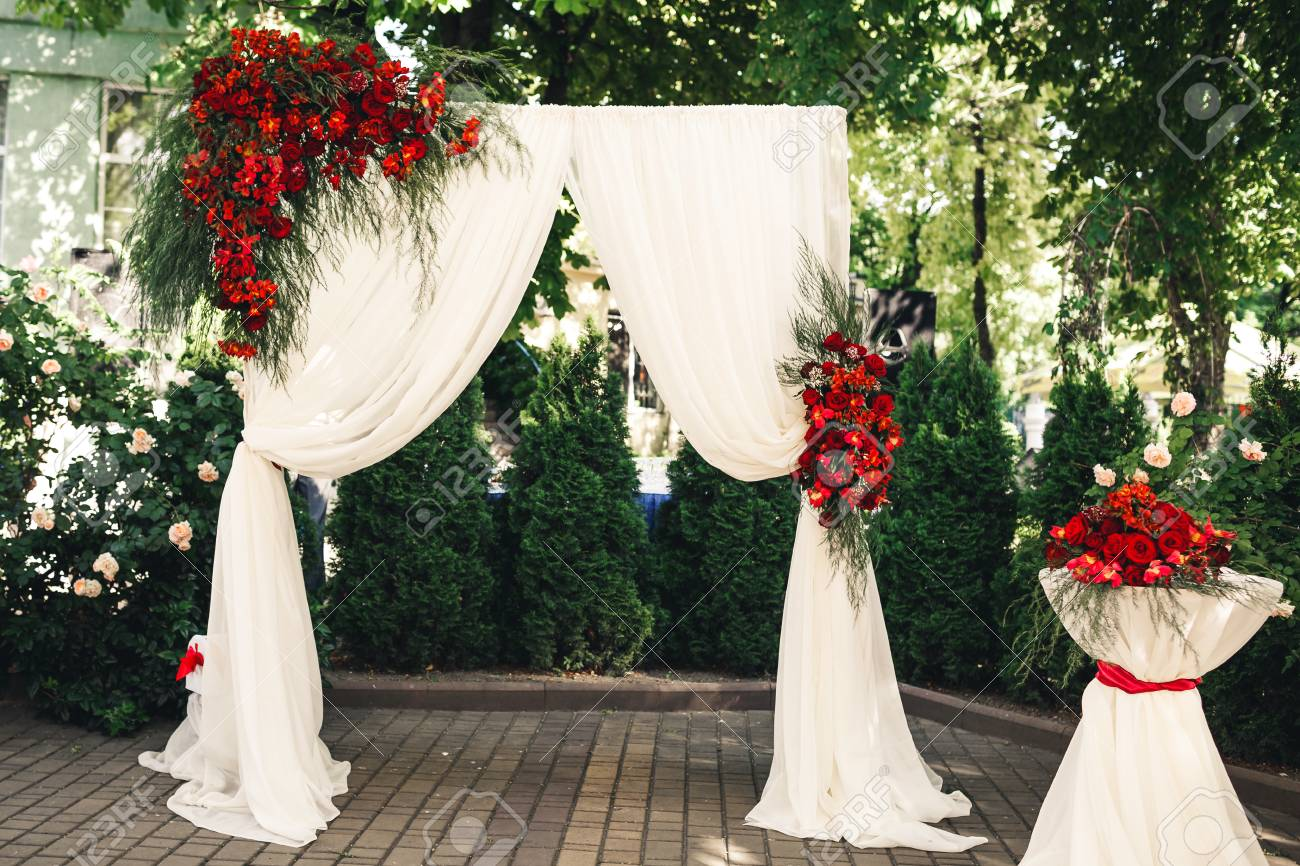 Wedding arch and table decorated with flowers wedding decorations stock photo wedding arch and table decorated with flowers wedding decorations junglespirit Gallery