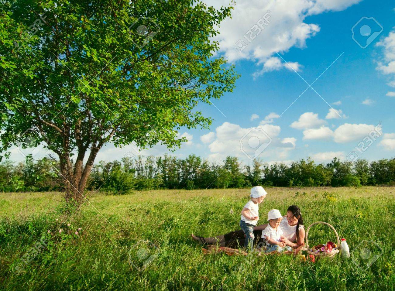 mother with children having picnic Stock Photo - 13370292
