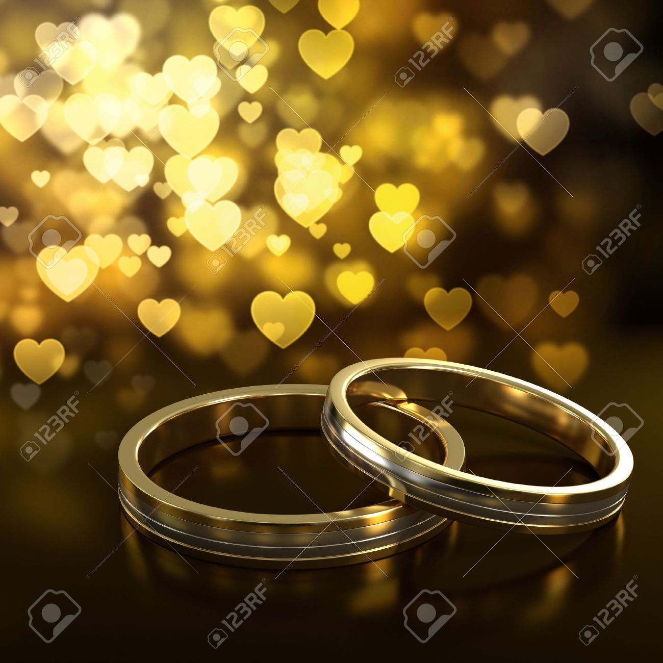 golden wedding two golden wedding rings with heart bokeh on background