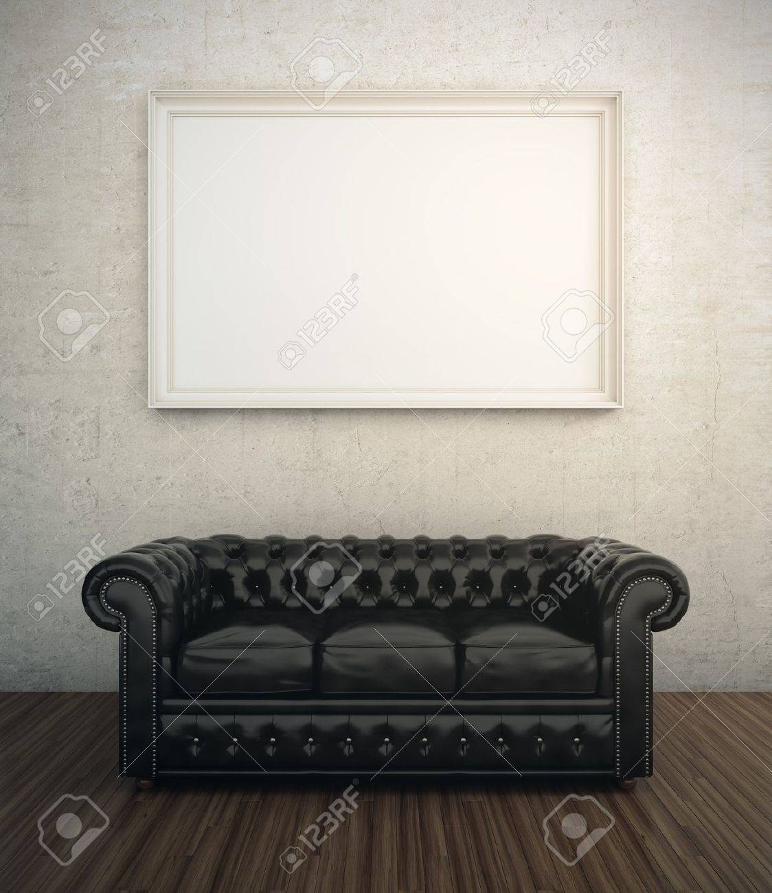 Black leather sofa next to white wall with blank frame Stock Photo - 21523104
