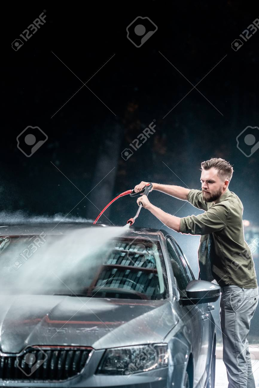 A Man With A Beard Washes A Gray Car With A High Pressure Apparatus At Night In A Car Wash Expensive Advertising Photography Lizenzfreie Fotos Bilder Und Stock Fotografie Image 107849046