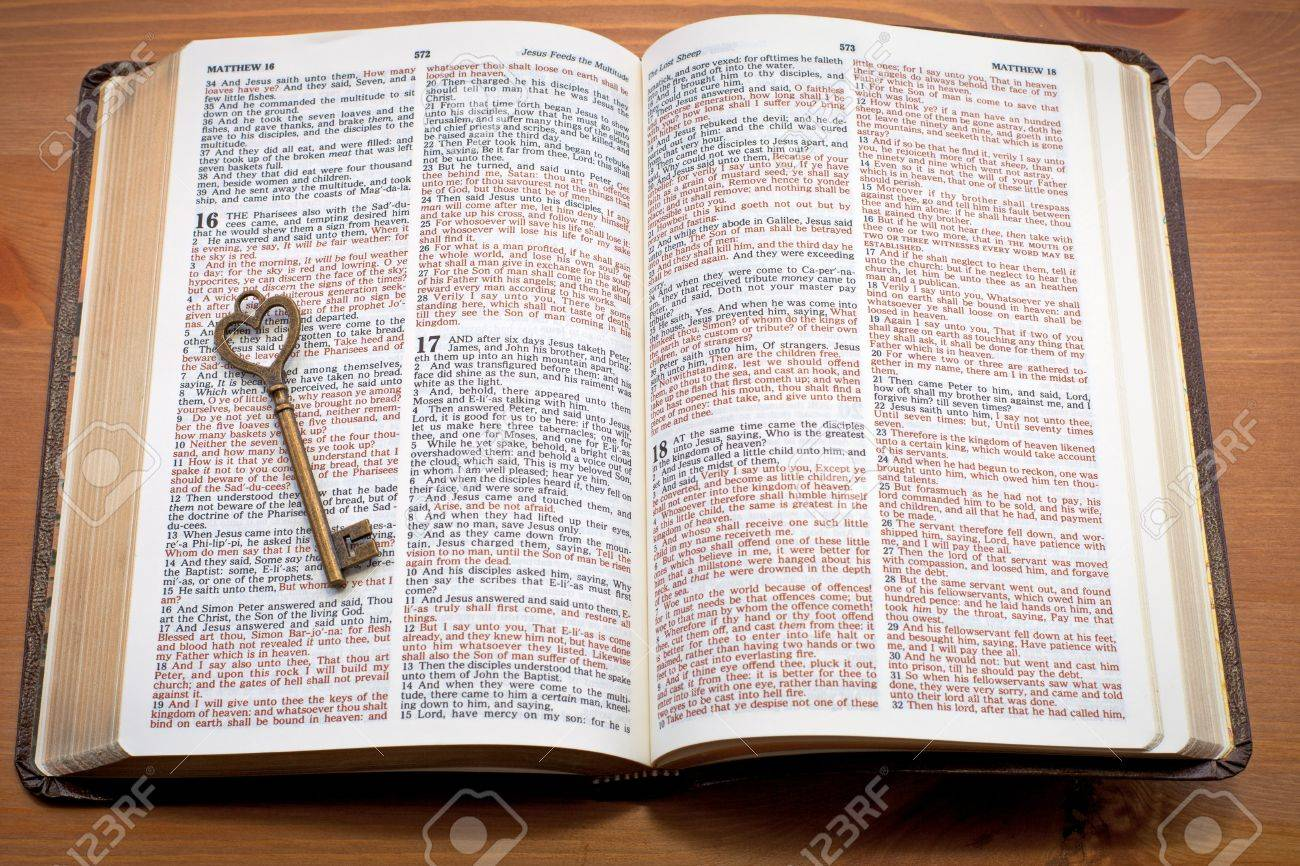 keys to the kingdom key on the open bible stock photo picture and