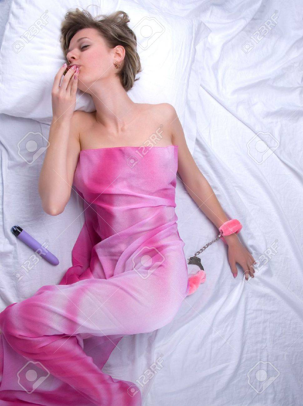 Young woman on bed with strawberry and sex toys Stock Photo - 7508310