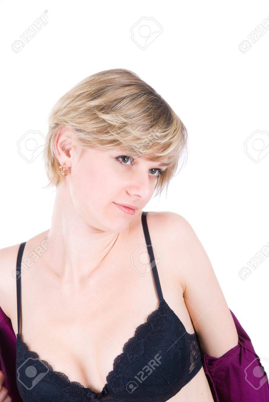 Sexy lifestyle picture - young blonde stripping isolated over white Stock Photo - 7810287