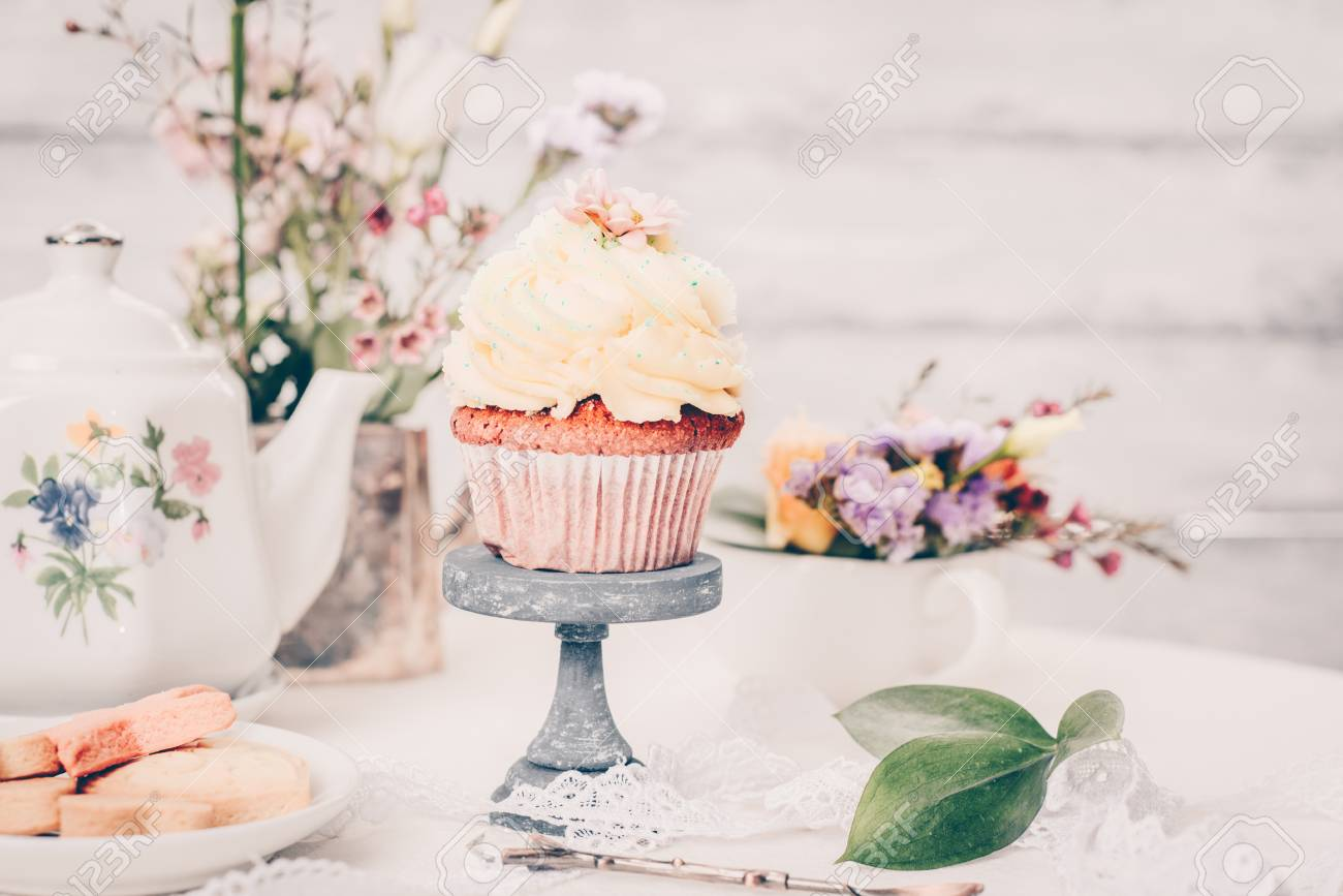 Cup Cakes With Cream Cheese Topping On Beautiful Wooden Cake Stock
