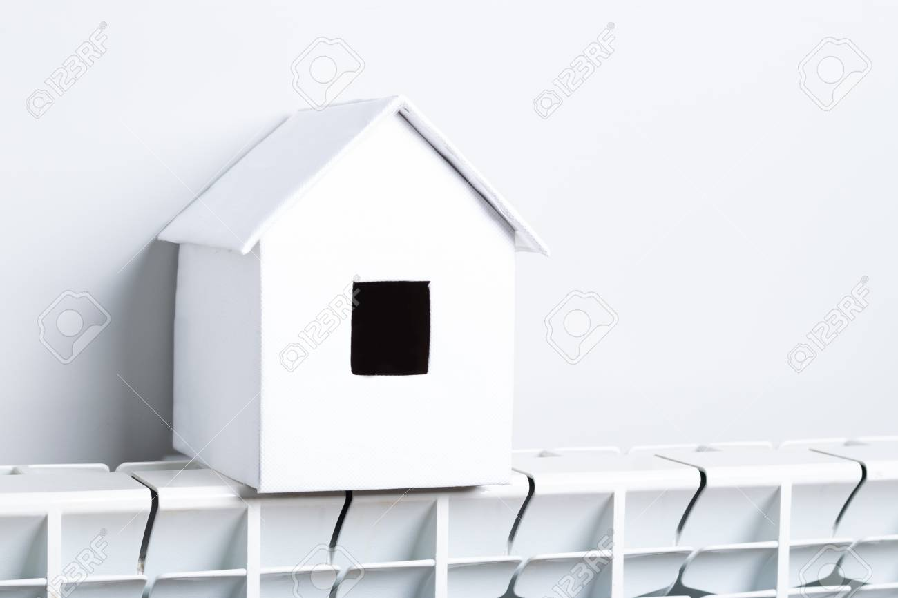 House In Winter Heating System Concept And Cold Snowy Weather With