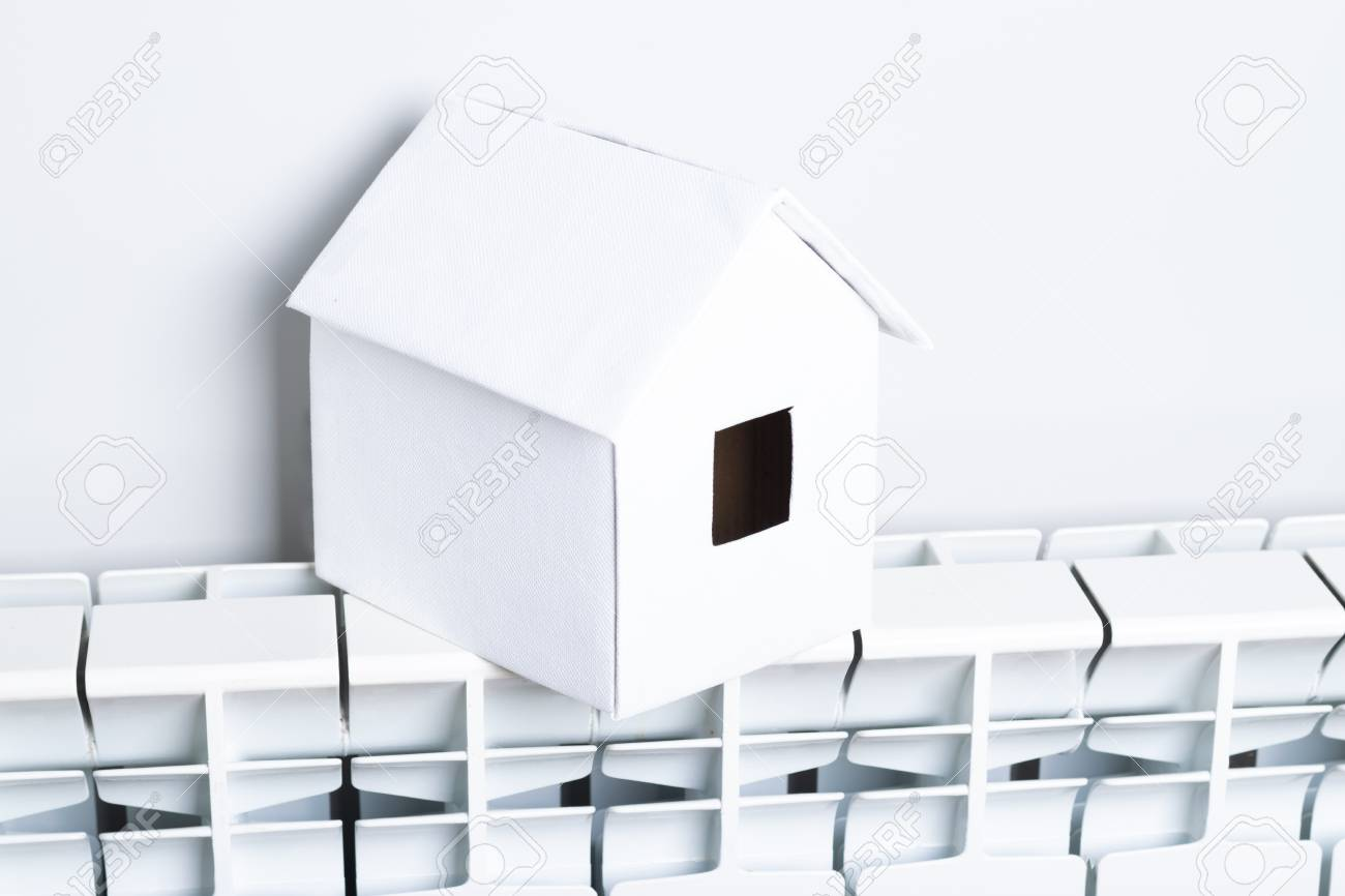 House In Winter Heating System Concept And Cold Snowy Weather