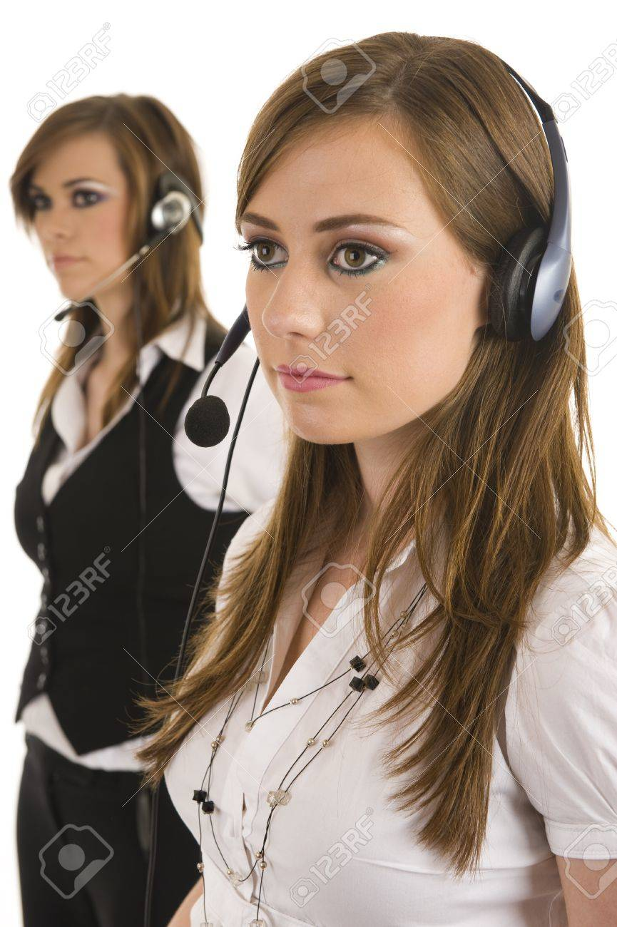 Young business ladies with headsets. Studio on isolated white background. Stock Photo - 6933772
