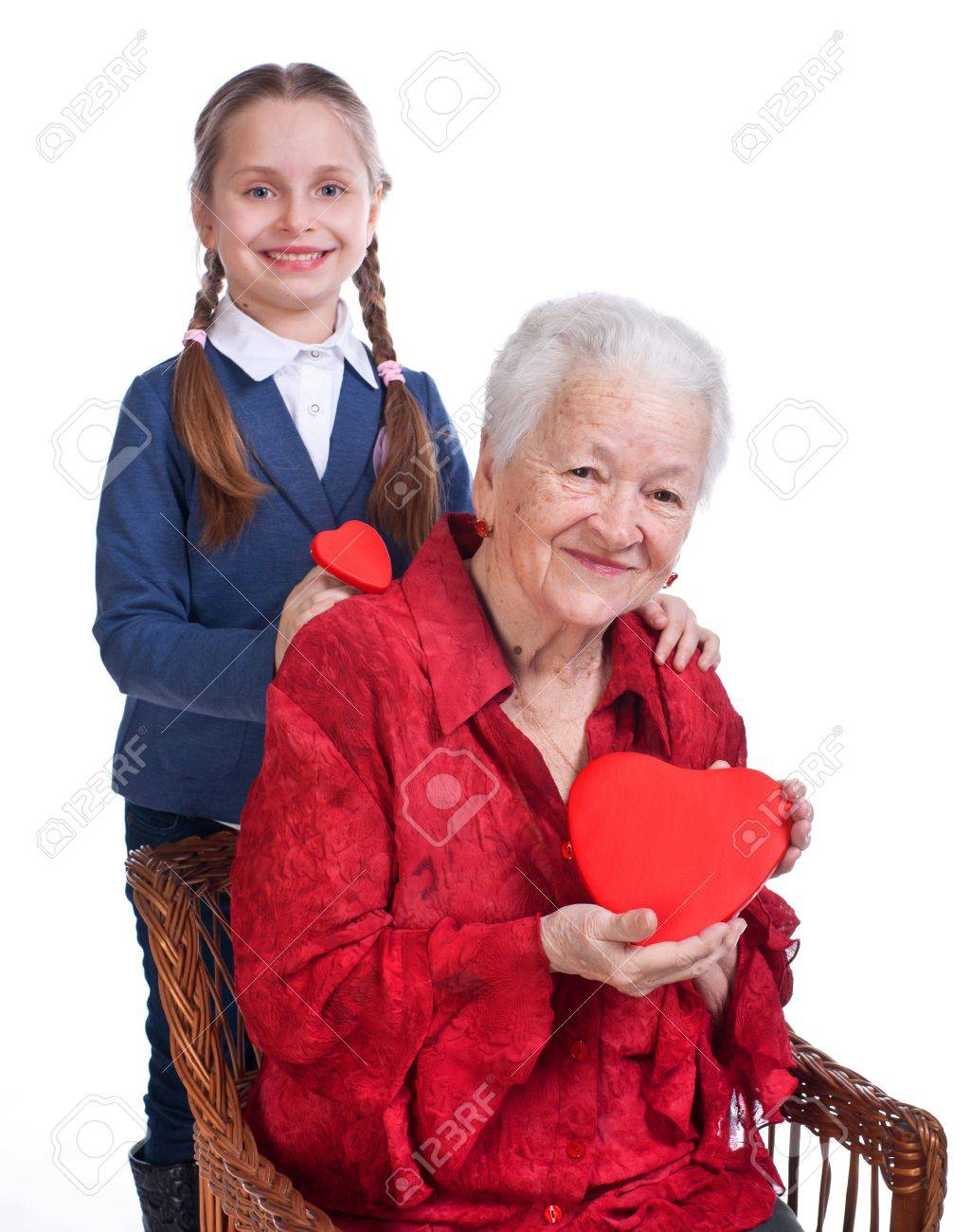 Granddaughter and grandmother with hearts on a white background Stock Photo - 17789211