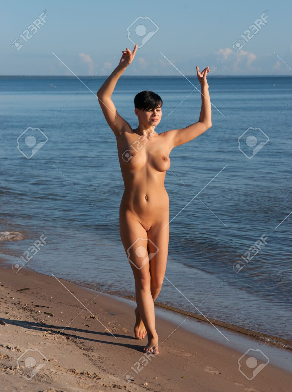 Young fully nude woman  posing against sea background Stock Photo - 18682042