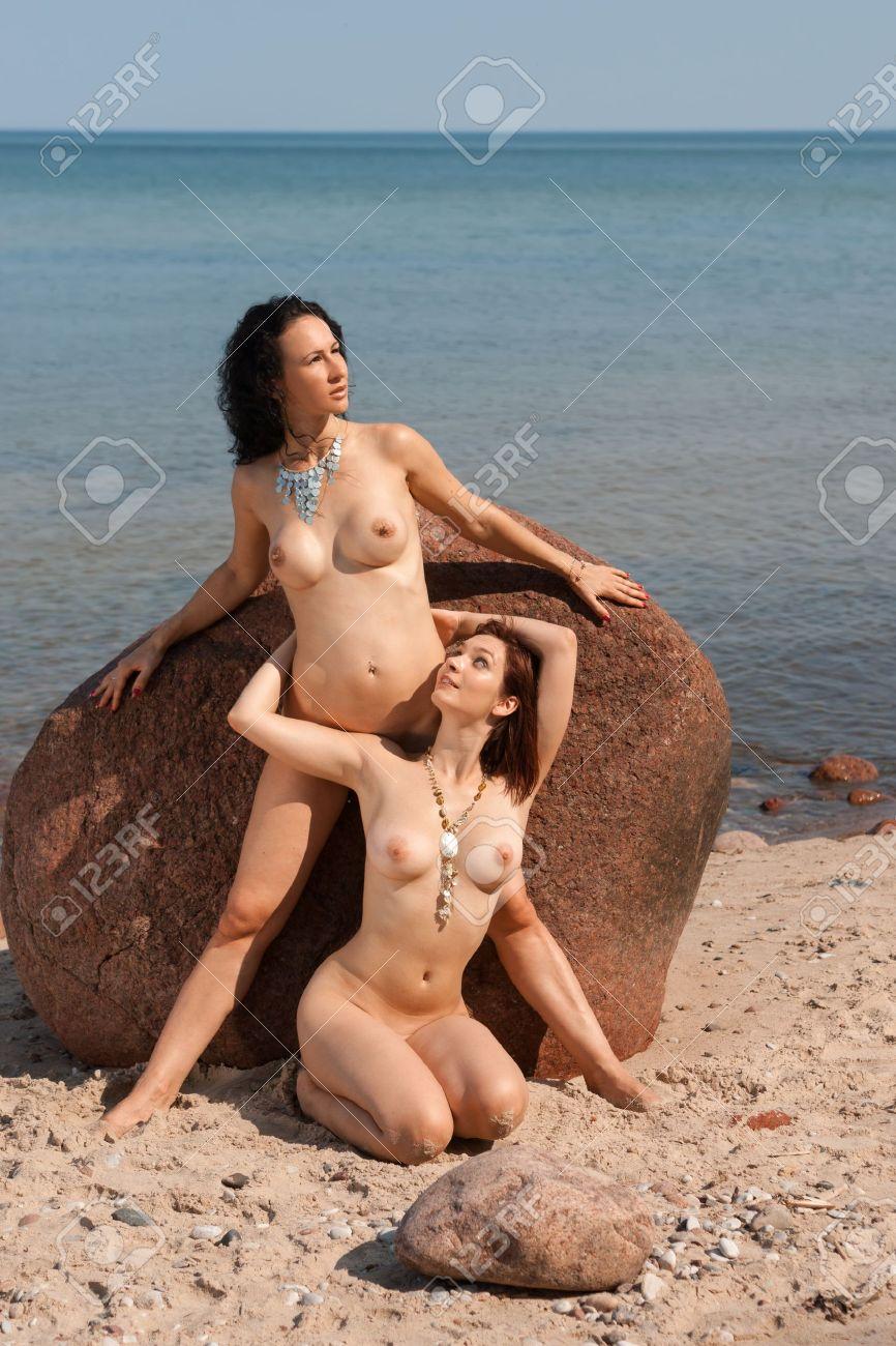 Nude female sunbathing