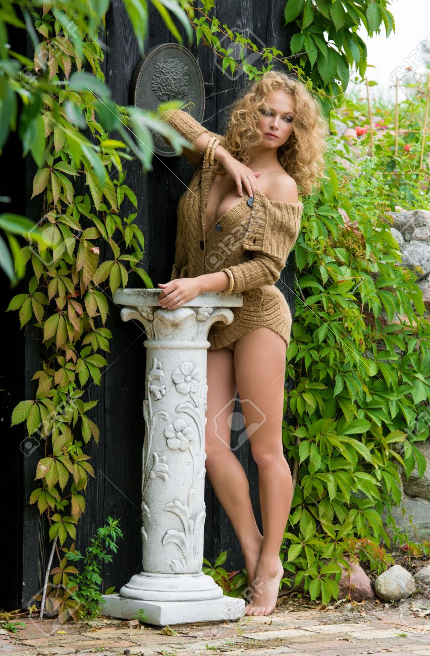 beautiful nude woman posing near the old country house stock photo