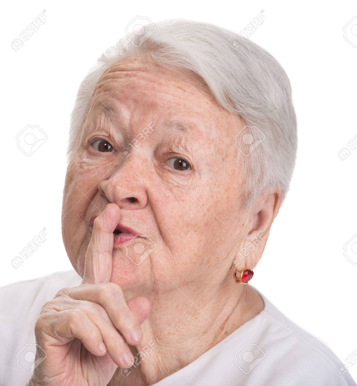 Old woman with finger on lips asking for silence on a white background Stock Photo - 27226880