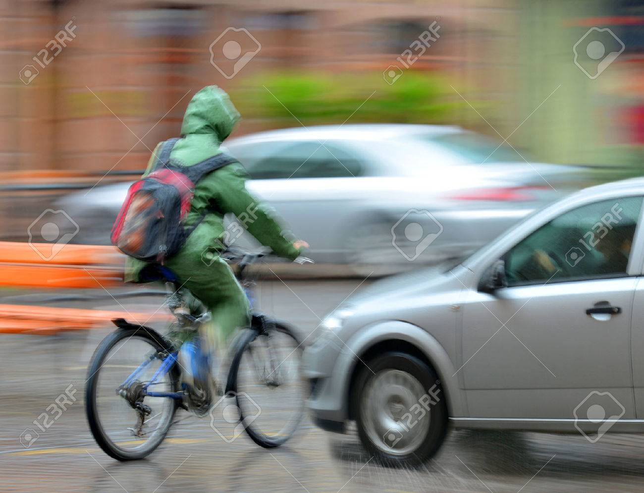 Dangerous city traffic situation with cyclist and car in the city in motion blur - 32767094