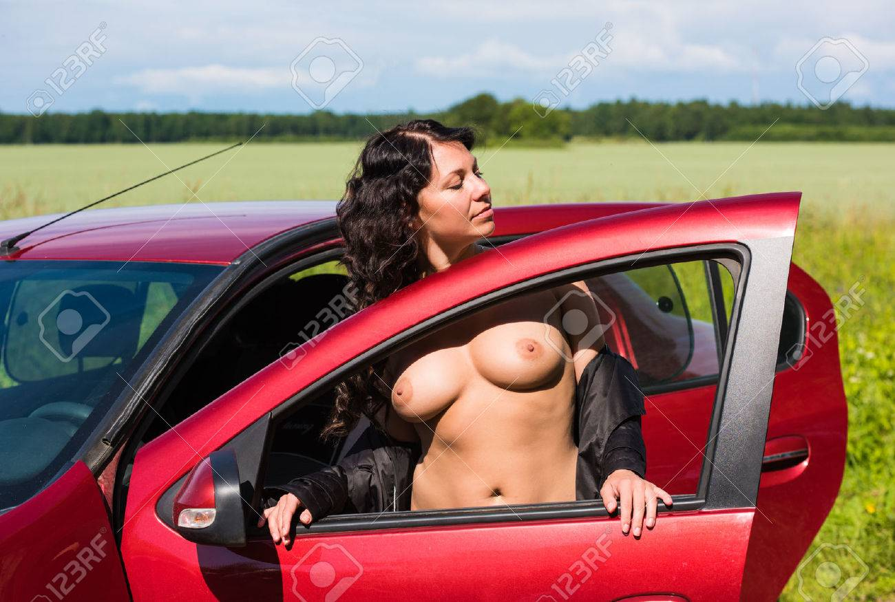 Beautiful nude women in car