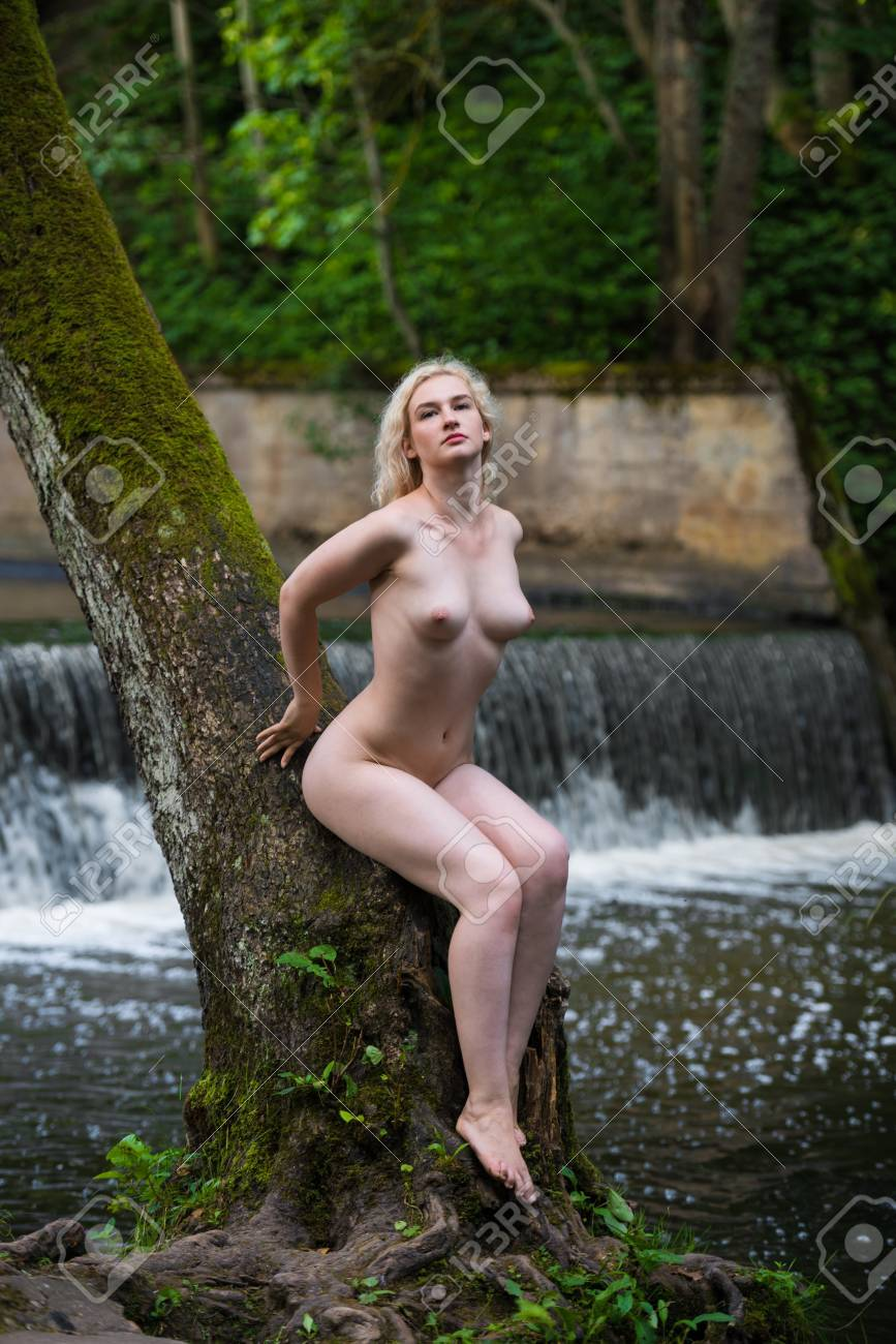 Sexy nude women near waterfall