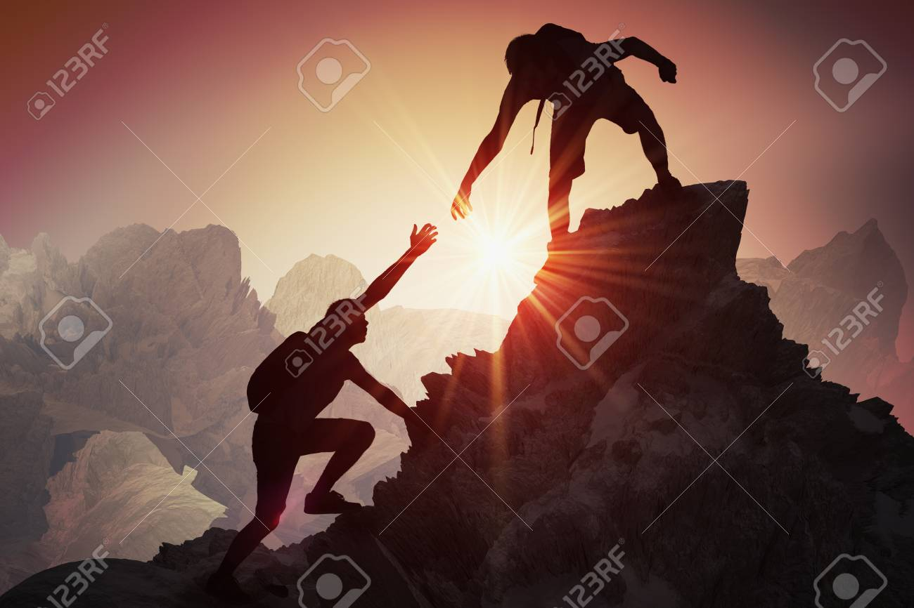 Help and assistance concept. Silhouettes of two people climbing on mountain and helping. - 93964184
