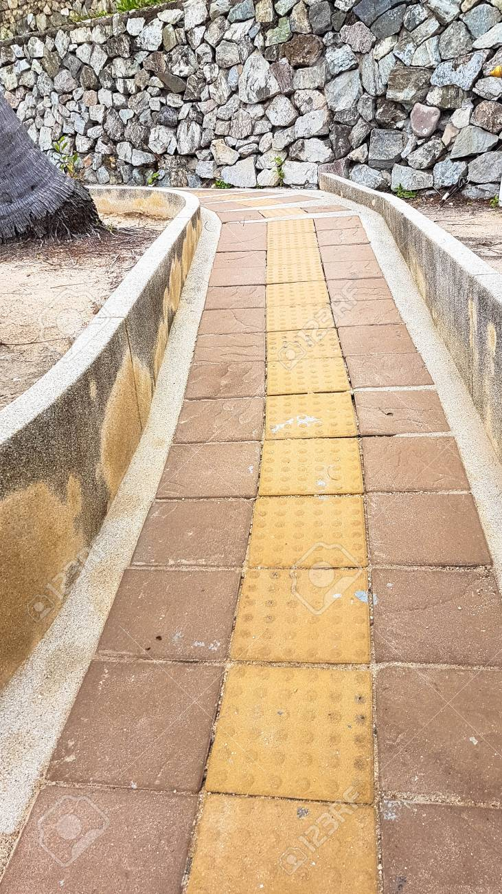 Slope Up Path Of Brick Walk Way In Garden And Decorate With Stone ...